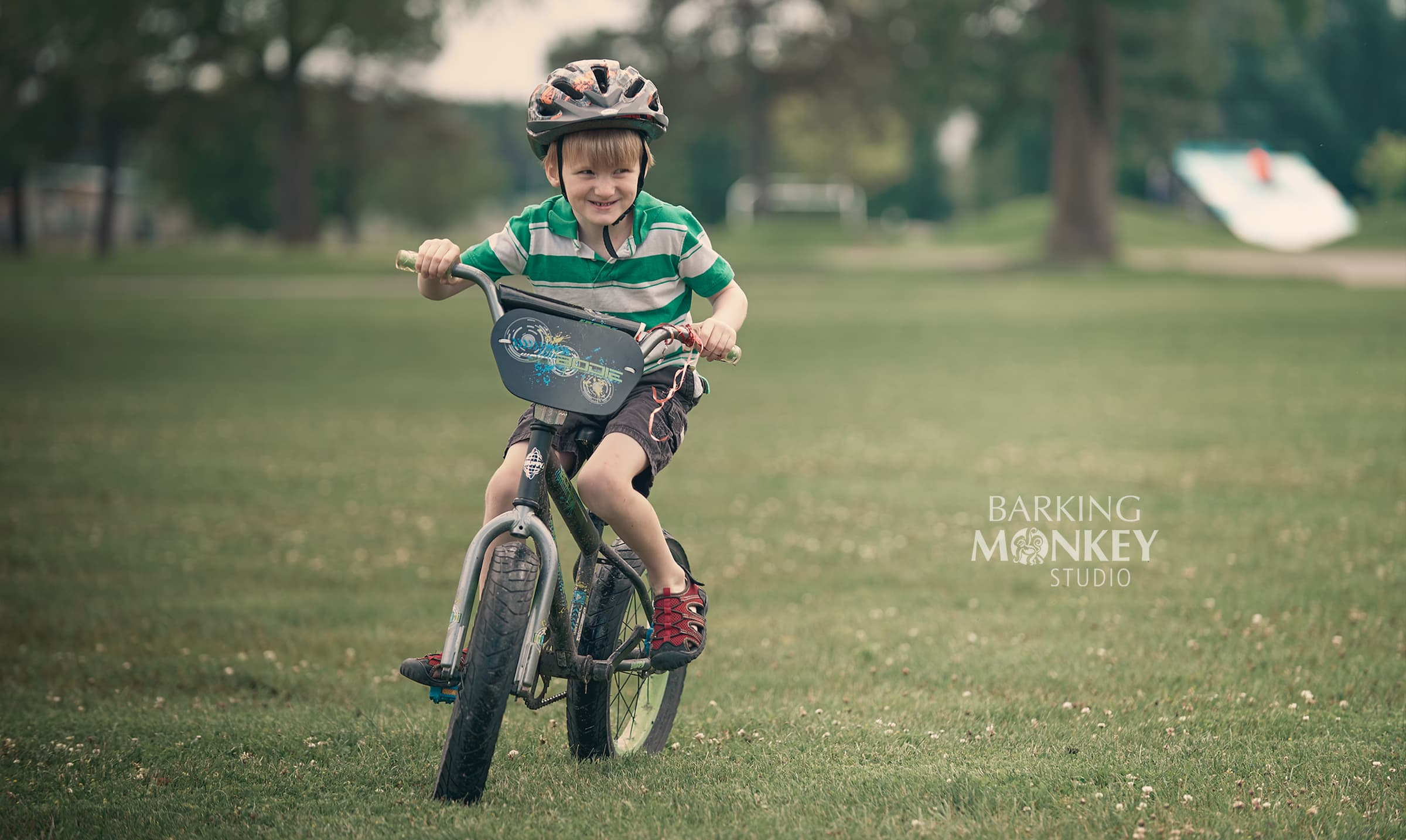 boy riding bicycle family portrait